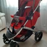 Красная прогулочная коляска